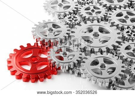 Heap Of Mechanical Gear Cogwheels Wiith One Red Key Cog Over White Background - Leadership, Industry