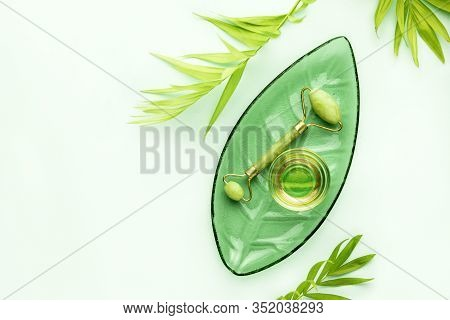 Spa Background With Jade Roller And Massage Natural Oil, Top Down View, Blank Space For A Text