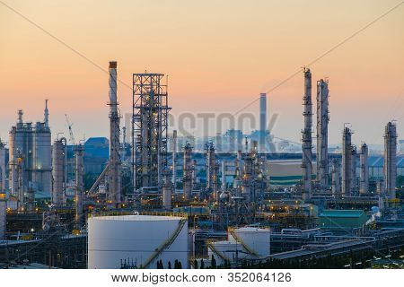 Oil And Gas Refinery Plant Or Petrochemical Industry On Sky Sunset Background, Heavy Equipment Of Hy
