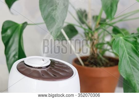White Air Humidifier Spreading Steam. Humidification Of Dry Air. Selective Focus On Vapor. On Backgr