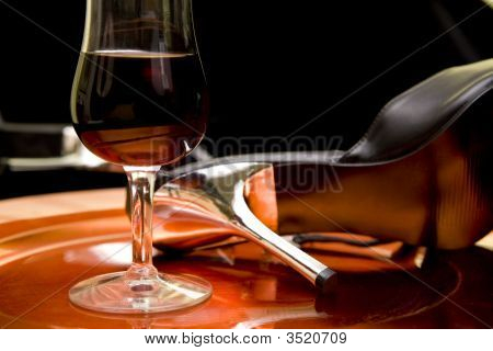 Red Wine And High Heels On A Tray
