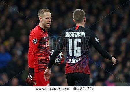 LONDON, ENGLAND. 19 FEBRUARY 2020. Goalkeeper Peter Gulacsi Of Leipzig and Defender Lukas Klostermann during the UEFA Champions League match between Tottenham Hotspur and RB Leipzig