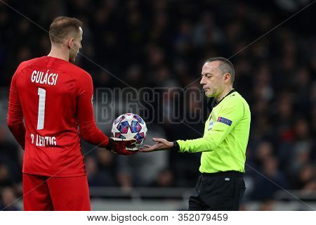 LONDON, ENGLAND. 19 FEBRUARY 2020. Goalkeeper Peter Gulacsi Of Leipzig and \Referee Cuneyt Cakir during the UEFA Champions League match between Tottenham Hotspur and RB Leipzig