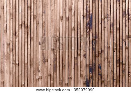 Bamboo Wood Panel. Decorative Old Grunge Brown Bamboo Wall Fence Background And Texture.