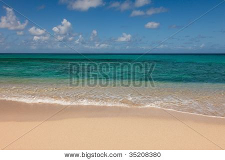 Beautiful Sandy Tropical Beach And Sunny Ocean Seascape