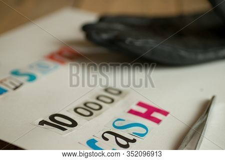 Kidnap Ransom Note And Black Glove In Cut Out Letters Demanding Cash