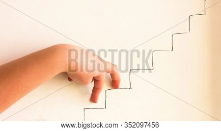 Human Hand Imitating Walking Upstairs. Concept Of Career Growth. Goal Achievement, Leadership And Pr