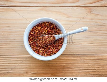 Spicy And Hot Crushed Dried Chili Peppers - Tucana Ljuta Paprika, In White Bowl A Wooden Table Backg
