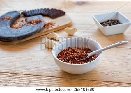 Spicy And Hot Crushed Dried Chili Peppers In White Bowl - Tucana Ljuta Paprika In Front Of Special I