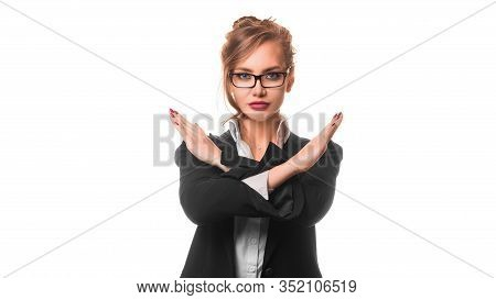 Serious Business Woman Shows A Stop Sign Crossed Hands. Isolated On White.