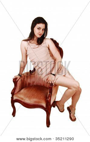 Girl Relaxing On Arm Chair.