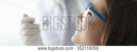 Close-up Of Smiling Beautiful Woman Visiting Professional Stomatologist. Wonderful Female With Long