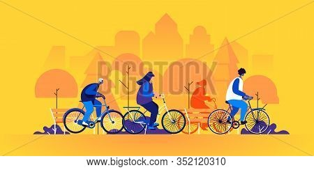 People Riding Bicycles. Young Men And Women On Bikes In Park. Friends Cycling Together. Group Of Bic