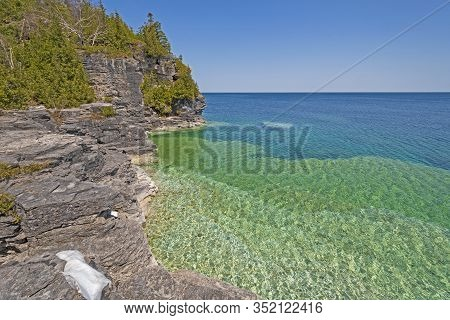 Rugged Cliffs And A Rocky Bay On Lake Huron In Bruce Peninsula National Park In Ontario