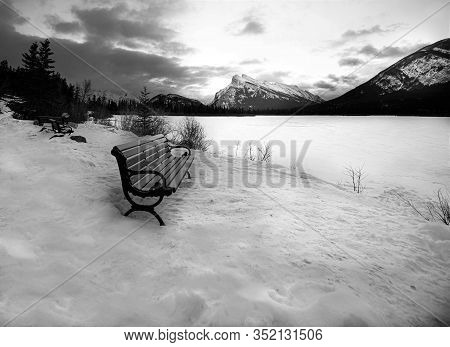 Bench At The Vermillion Lake, Banff National Park, Canada.