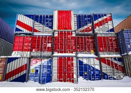 The National Flag Of United Kingdom On A Large Number Of Metal Containers For Storing Goods Stacked