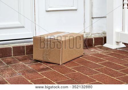 Cardboard Box Delivered To Front Door At Front Door Step