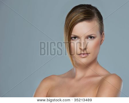 Beauty Portrait Of Serous Young Woman Isolated On Gray