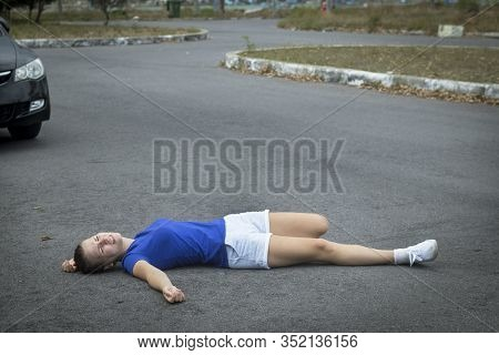 Downed Girl By Car, Young Unconscious Woman Lying On Road, Asphault, Suffering From Pain, Injury Or