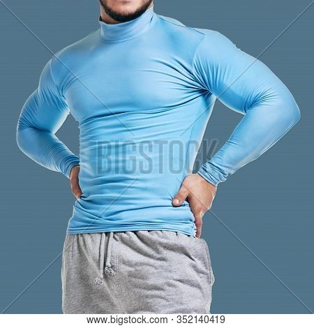 Muscular Athletic Male Bodybuilder Isolated On Blue Background