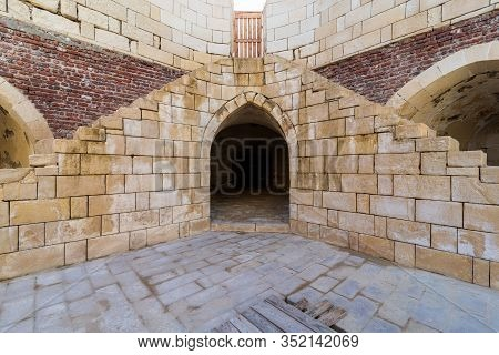 Symmetric Exterior Shot Of Ancient Brick Building With Two Shabby Stone Stairways Leading To Closed