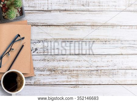 Wood Office Desk Table With Notebook, Cup Of Coffee And Glasses,flat Lay. Top View With Copy Space (