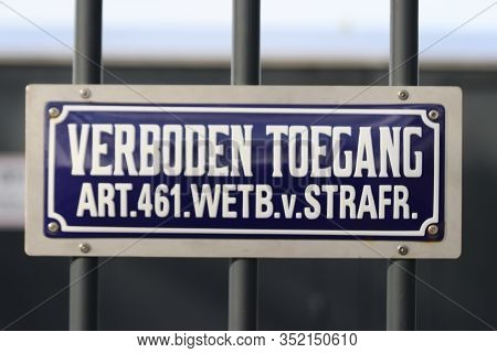 """Typical Dutch Blue And White Sign With Text """"verboden Toegang"""" Which Means No Admittance With Law Ar"""