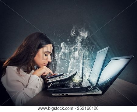 Businesswoman Works With Multiple Devices, Smartphone, Calculator And Laptops. Concept Of Overwork A