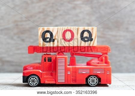 Red Fire Truck Hold Letter Block In Word Qoq (abbreviation Of Quarter On Quarter) On Wood Background
