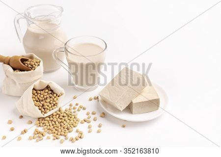 Soy And Derivatives. Soy Milk, White Blocks Cheese. Soy Milk In Cup And Jug