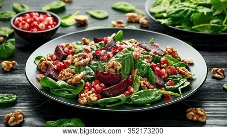 Healthy Beet Salad With Fresh Sweet Baby Spinach, Pomegranate Seeds And Candy Walnut. Healthy Vegan