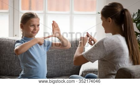 Smiling Happy Adorable Girl Communicating Nonverbal With Deaf Dumb Mother.