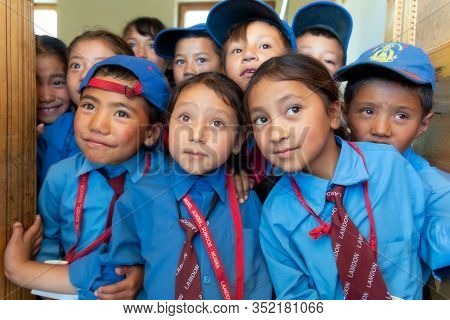 Sumur, India - August 20, 2015: Curious Students Look Out Of The Classroom At Lamdon School. The Lam