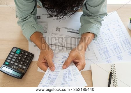 Image Of A Business Man With Financial Concerns. Think Hard About Paying Off Credit Card Debt, House