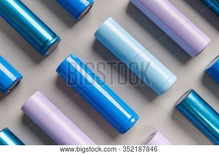 Close Up Of Colorful Used Rechargeable Nickel Metal Hydride (ni-mh) Battery On Grey Background, Flat