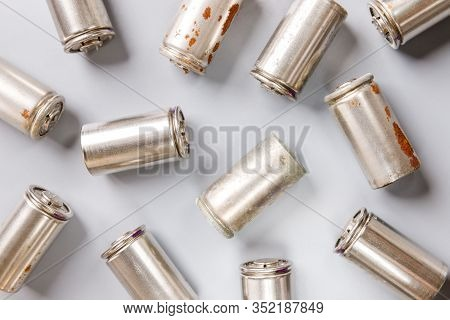 Close Up Of Spent Used Rechargeable Nickel Metal Hydride (ni-mh) Battery On Grey Background, Flat La