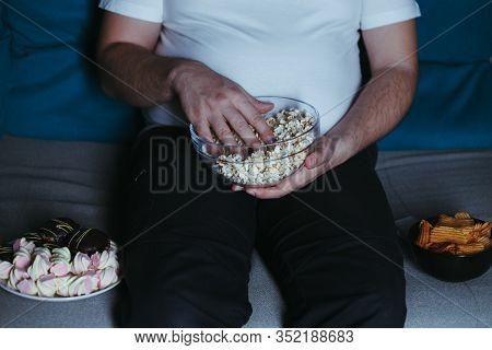 Nerve Food, Addiction, Eating Disorders, Bulimia. Overweight Man Sit On The Coach With Big Amount Of