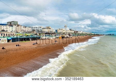 Brighton, England - October 21, 2019: Brighton Pier And Brighton Beach The Popular Place For Enterta