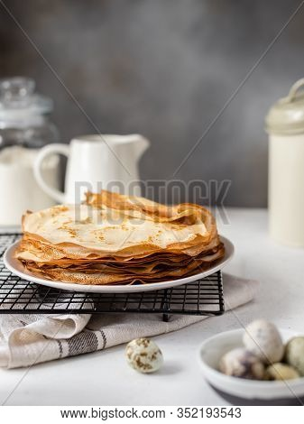 Stack Of Thin Crepes, Pancakes. Homemade Breakfast. Shrove Tuesday, Maslenitsa Holiday Concept. Vert