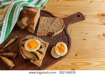 Scandinavian Breakfast With Boiled Egg, Small Fish And Rye Bread. Ingredients For Sandwiches. Horizo