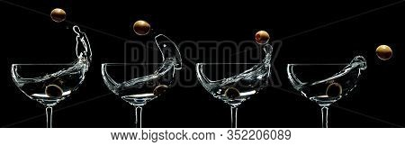 Set Of Martini Splash. Silhouette Of Martini With Green Olives On A Black Background.