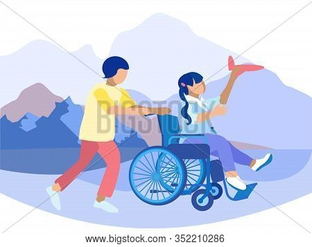 Boy Pushing Wheelchair With Disabled Girl Sitting And Playing Toy Airplane. Highland Landscape. Phys