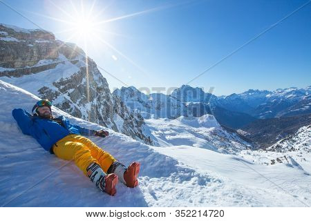 Skier Resting In Winter Mountains