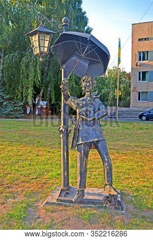 Kiev, Ukraine - Aug 30, 2019: Forged Metal Men With Umbrella In The Kyiv City Psychiatric Hospital N