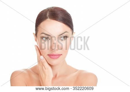 Beauty With Flawless Skin. Natural Brunette Model Posing With Hands Touching Face Showing Clean Skin