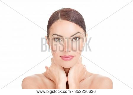 Beauty With Flawless Skin. Natural Brunette Model Posing With Hands Touching Neck, Face Showing Clea