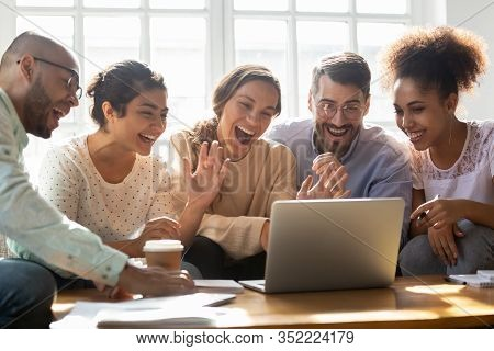 Five Multi-ethnic Friends Make Videocall Looking At Laptop Screen