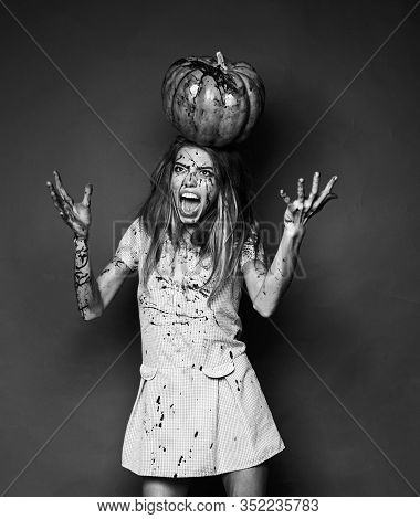 Crazy Woman Bloody Dress - Halloween Portrait. Woman With Red Blood And With Blond Hair. Pretty Youn