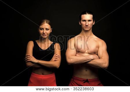 Sports For All. Sexy Fit Couple Black Background. Professional Sports Team. Athletic Man And Woman K