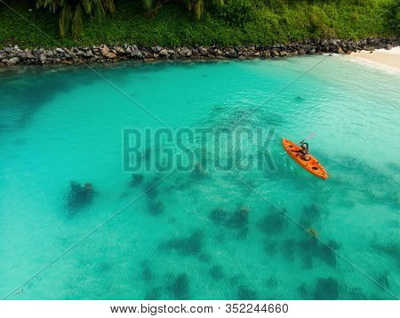 Aerial View Of Woman Kayaking In A Lagoon In Eden Island, Seychelles. Top View Of Woman Floating On